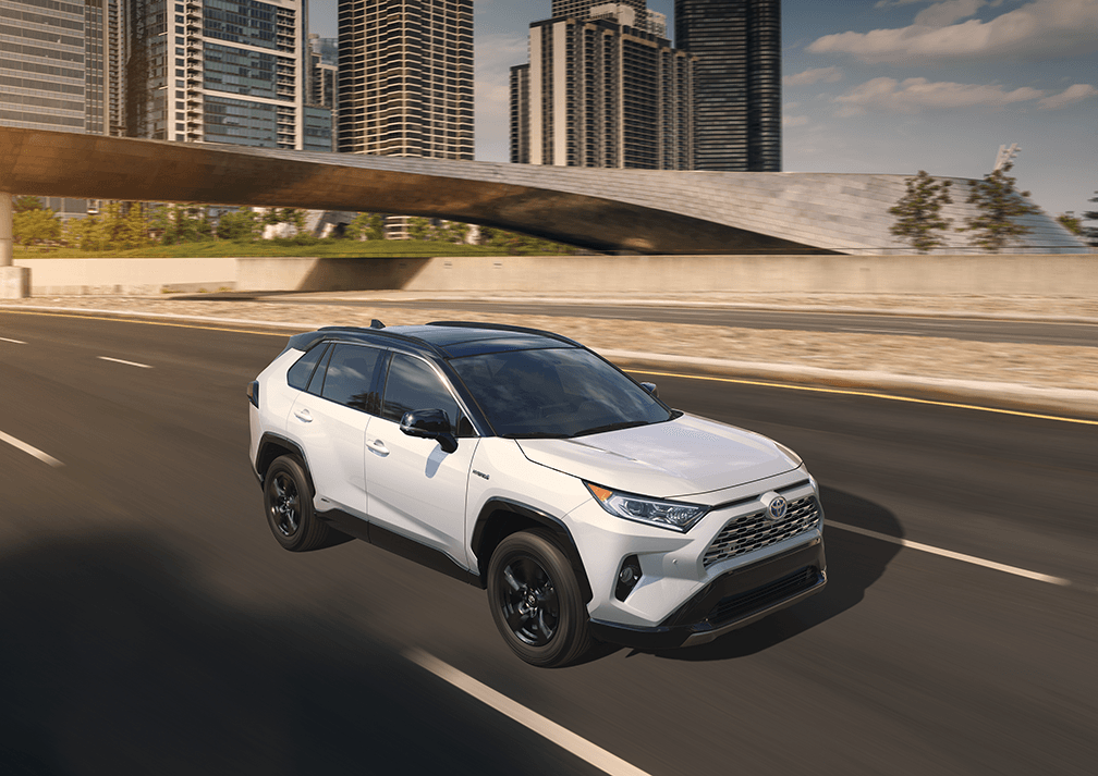 White 2019 RAV4 XSE Hybrid on road