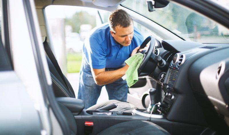 man-cleaning-steering-wheel
